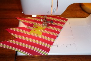 Sewing on the applique letter